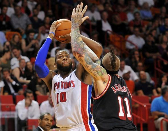 Feb 3, 2014; Miami, FL, USA; Detroit Pistons power forward Greg Monroe (10) is pressured by Miami Heat power forward Chris Andersen (11) during the first half at American Airlines Arena. Mandatory Credit: Steve Mitchell-USA TODAY Sports