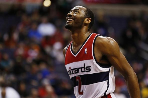 Feb 3, 2014; Washington, DC, USA; Washington Wizards point guard John Wall (2) smiles on the court against the Portland Trail Blazers in the fourth quarter at Verizon Center. The Wizards won 100-90. Mandatory Credit: Geoff Burke-USA TODAY Sports