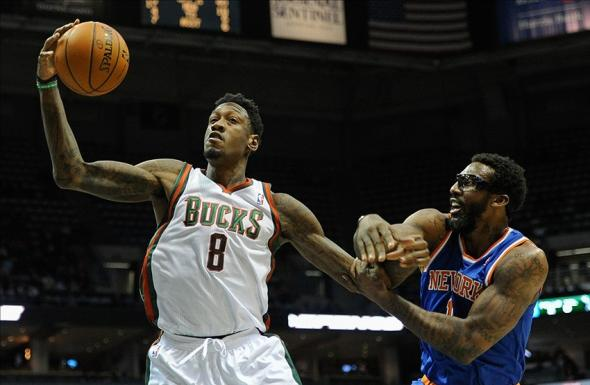 Feb 3, 2014; Milwaukee, WI, USA; Milwaukee Bucks center Larry Sanders (8) grabs a rebound against New York Knicks forward Amar