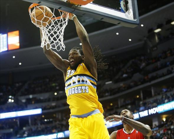 Feb 3, 2014; Denver, CO, USA; Denver Nuggets forward Kenneth Faried (35) dunks the ball during the first half against the Los Angeles Clippers at Pepsi Center. Mandatory Credit: Chris Humphreys-USA TODAY Sports