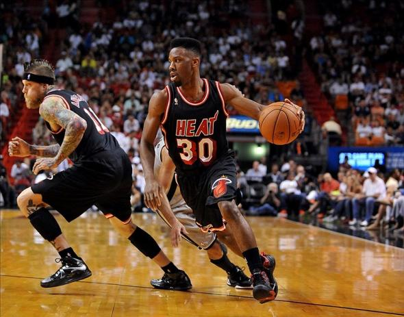 Jan 26, 2014; Miami, FL, USA; Miami Heat point guard Norris Cole (30) drives to the basket basket against the San Antonio Spurs during the first half at American Airlines Arena. Mandatory Credit: Steve Mitchell-USA TODAY Sports