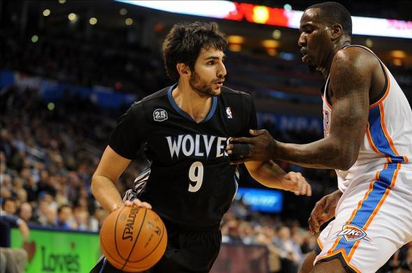 Feb 5, 2014; Oklahoma City, OK, USA; Minnesota Timberwolves point guard Ricky Rubio (9) drives the ball against Oklahoma City Thunder center Kendrick Perkins (5) during the second quarter at Chesapeake Energy Arena. Mandatory Credit: Mark D. Smith-USA TODAY Sports