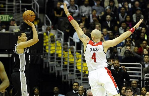 Feb 5, 2014; Washington, DC, USA; San Antonio Spurs shooting guard Danny Green (4) shoots over Washington Wizards center Marcin Gortat (4) during overtime at Verizon Center. The Spurs defeated the Wizards 125 - 118 in double overtime. Mandatory Credit: Brad Mills-USA TODAY Sports