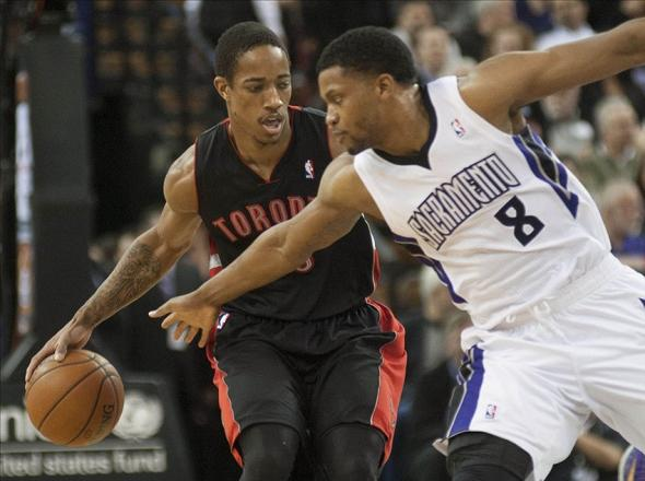Feb 5, 2014; Sacramento, CA, USA; Sacramento Kings small forward Rudy Gay (8) attempts to steal the ball from Toronto Raptors shooting guard DeMar DeRozan (10) during the first quarter at Sleep Train Arena. Mandatory Credit: Ed Szczepanski-USA TODAY Sports