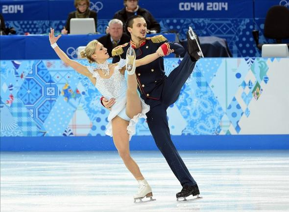 Feb 6, 2014; Sochi, RUSSIA; Tatiana Volosozhar and Maxim Trankov (RUS) perform in the figure skating team pairs short program during the Sochi 2014 Olympic Winter Games at Iceberg Skating Palace. Mandatory Credit: Robert Deutsch-USA TODAY Sports