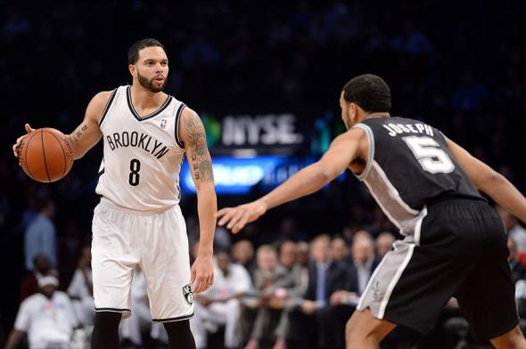 Feb 6, 2014; Brooklyn, NY, USA; Brooklyn Nets point guard Deron Williams (8) dribbles against San Antonio Spurs point guard Cory Joseph (5) during the first half at Barclays Center. Mandatory Credit: Joe Camporeale-USA TODAY Sports