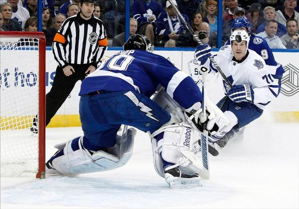 Feb 6, 2014; Tampa, FL, USA; Toronto Maple Leafs right wing David Clarkson (71) looks at the puck as Tampa Bay Lightning goalie Ben Bishop (30) defends during the first period at Tampa Bay Times Forum. Mandatory Credit: Kim Klement-USA TODAY Sports