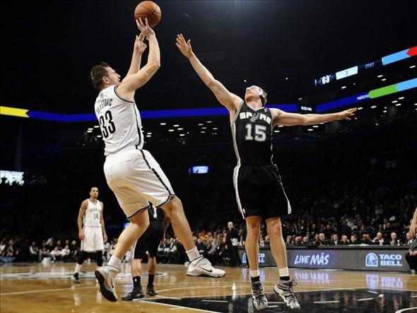 Feb 6, 2014; Brooklyn, NY, USA; Brooklyn Nets power forward Mirza Teletovic (33) shoots over San Antonio Spurs power forward Matt Bonner (15) during the first half at Barclays Center. Mandatory Credit: Joe Camporeale-USA TODAY Sports