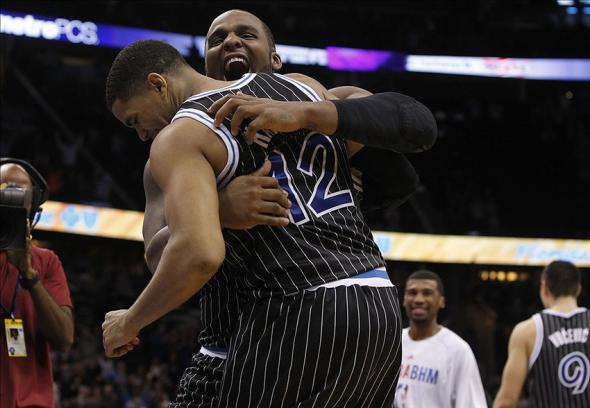 Feb 7, 2014; Orlando, FL, USA; Orlando Magic small forward Tobias Harris (12) celebrates with power forward Glen Davis (11) after scoring against the Oklahoma City Thunder during the second half at Amway Center. The Orlando Magic won 103-102. Mandatory Credit: Kim Klement-USA TODAY Sports