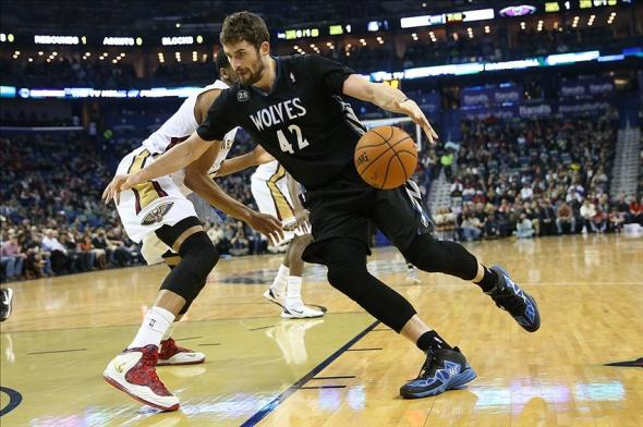 Feb 7, 2014; New Orleans, LA, USA; Minnesota Timberwolves power forward Kevin Love (42) drives toward the basket in front of New Orleans Pelicans power forward Anthony Davis (behind) in the first half at the Smoothie King Center. Mandatory Credit: Crystal LoGiudice-USA TODAY Sports