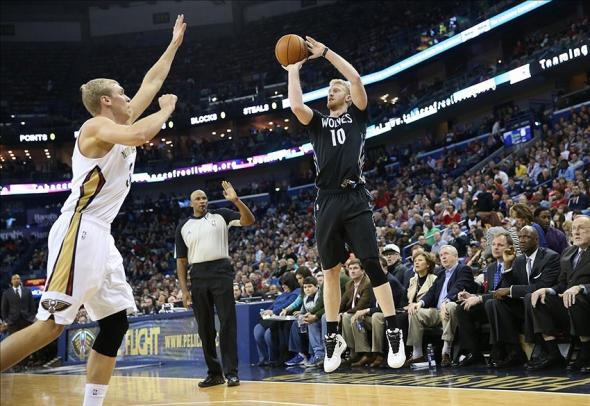 Feb 7, 2014; New Orleans, LA, USA; Minnesota Timberwolves small forward Chase Budinger (10) shoots the ball over New Orleans Pelicans center Greg Stiemsma (34) in the first half at the Smoothie King Center. Mandatory Credit: Crystal LoGiudice-USA TODAY Sports