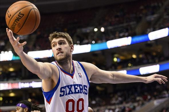 Feb 7, 2014; Philadelphia, PA, USA; Philadelphia 76ers center Spencer Hawes (00) grabs a rebound during the second quarter against the Los Angeles Lakers at the Wells Fargo Center. The Lakers defeated the Sixers 112-98. Mandatory Credit: Howard Smith-USA TODAY Sports