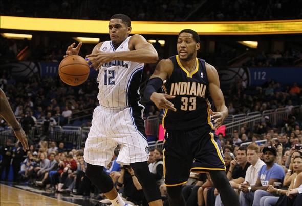 Feb 9, 2014; Orlando, FL, USA; Orlando Magic small forward Tobias Harris (12) defends Indiana Pacers small forward Danny Granger (33) during the second half at Amway Center. Orlando Magic defeated the Indiana Pacers 93-92. Mandatory Credit: Kim Klement-USA TODAY Sports