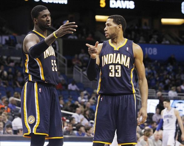 Feb 9, 2014; Orlando, FL, USA; Indiana Pacers center Roy Hibbert (55) and small forward Danny Granger (33) talk against the Orlando Magic during the second half at Amway Center. Orlando Magic defeated the Indiana Pacers 93-92. Mandatory Credit: Kim Klement-USA TODAY Sports