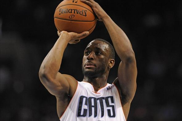 Feb 11, 2014; Charlotte, NC, USA; Charlotte Bobcats guard Kemba Walker (15) shoots the ball during the second half against the Dallas Mavericks at Time Warner Cable Arena. The Bobcats won 114-89. Mandatory Credit: Sam Sharpe-USA