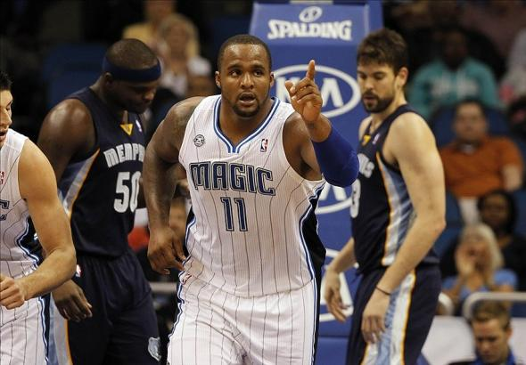 Feb 12, 2014; Orlando, FL, USA; Orlando Magic power forward Glen Davis (11) reacts and points after he made a basket against the Memphis Grizzlies during the first quarter at Amway Center. Mandatory Credit: Kim Klement-USA TODAY Sports