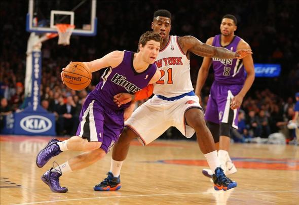 Feb 12, 2014; New York, NY, USA; Sacramento Kings point guard Jimmer Fredette (7) drives to the basket during the second half against New York Knicks shooting guard Iman Shumpert (21) at Madison Square Garden. Mandatory Credit: Jim O'Connor-USA TODAY Sports
