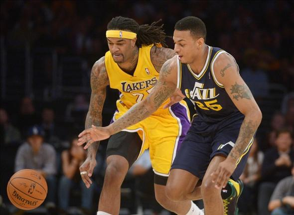 Feb 11, 2014; Los Angeles, CA, USA; Utah Jazz guard Brandon Rush (25) and Los Angeles Lakers forward Jordan Hill (27) battle for the ball at Staples Center. Mandatory Credit: Kirby Lee-USA TODAY Sports
