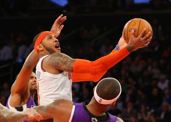 Feb 12, 2014; New York, NY, USA; New York Knicks small forward Carmelo Anthony (7) drives to the basket during the second half against the Sacramento Kings at Madison Square Garden. Sacramento Kings defeat the New York Knicks 106-101 in OT. Mandatory Credit: Jim O