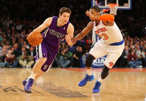 Feb 12, 2014; New York, NY, USA; Sacramento Kings point guard Jimmer Fredette (7) brings the ball up court during the first half against New York Knicks shooting guard Toure' Murry (23) at Madison Square Garden. Mandatory Credit: Jim O'Connor-USA TODAY Sports