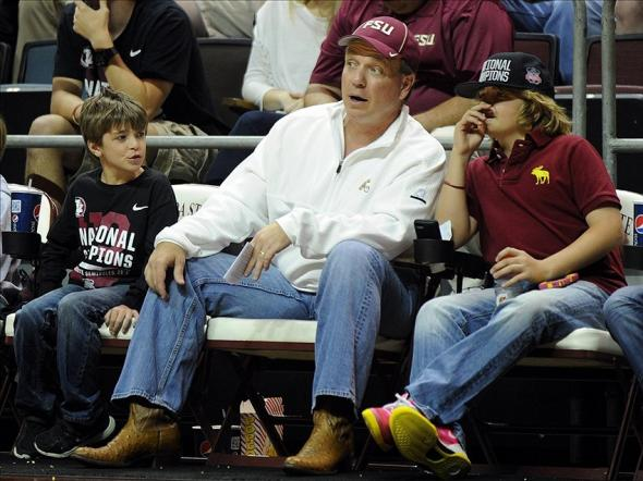 Feb 17, 2014; Tallahassee, FL, USA; Florida State Seminoles head football coach Jimbo Fisher, sons Ethan and Trey watch the Florida State game against the North Carolina Tarheels at the Donald L. Tucker Center. Mandatory Credit: Melina Vastola-USA TODAY Sports