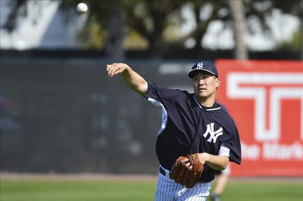 Feb 19, 2014; Tampa, FL, USA; New York Yankees pitcher Masahiro Tanaka (19) throws during spring morning practice at George M. Steinbrenner Field. Mandatory Credit: Tommy Gilligan-USA TODAY Sports
