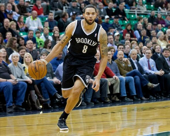 Feb 19, 2014; Salt Lake City, UT, USA; Brooklyn Nets point guard Deron Williams (8) dribbles the ball during the first quarter against the Utah Jazz at EnergySolutions Arena. Mandatory Credit: Russ Isabella-USA TODAY Sports