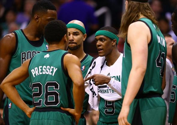 Feb 19, 2014; Phoenix, AZ, USA; Boston Celtics guard Rajon Rondo (center) talks to his players during a first half time out against the Phoenix Suns at US Airways Center. Mandatory Credit: Mark J. Rebilas-USA TODAY Sports