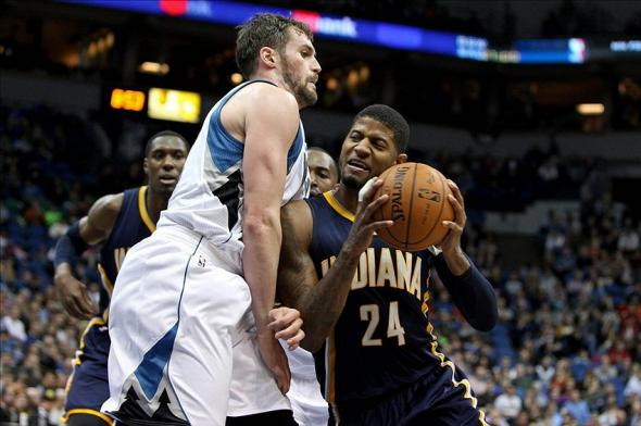Feb 19, 2014; Minneapolis, MN, USA; Indiana Pacers forward Paul George (24) moves past Minnesota Timberwolves forward Kevin Love (42) during the third quarter at Target Center. The Timberwolves defeated the Pacers 104-91. Mandatory Credit: Brace Hemmelgarn-USA TODAY Sports