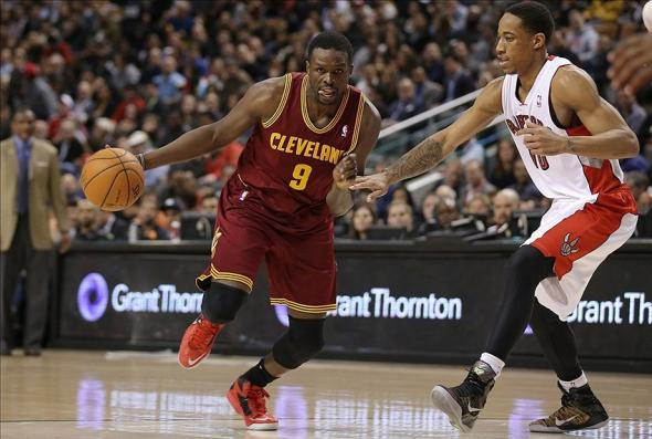 Feb 21, 2014; Toronto, Ontario, CAN; Cleveland Cavaliers forward Luol Deng (9) dribbles the ball around Toronto Raptors guard DeMar DeRozan (10) at Air Canada Centre. The Raptors won 98-91. Mandatory Credit: Tom Szczerbowski-USA TODAY Sports