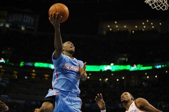 Feb 23, 2014; Oklahoma City, OK, USA; Los Angeles Clippers shooting guard Jamal Crawford (11) attempts a shot against Oklahoma City Thunder small forward Kevin Durant (35) during the second quarter at Chesapeake Energy Arena. Mandatory Credit: Mark D. Smith-USA TODAY Sports
