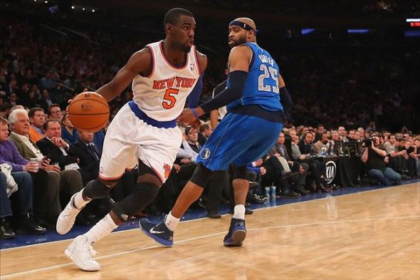 Feb 24, 2014; New York, NY, USA; New York Knicks shooting guard Tim Hardaway Jr. (5) dribbles the ball around Dallas Mavericks shooting guard Vince Carter (25) during the third quarter at Madison Square Garden. Dallas Mavericks won 110-108. Mandatory Credit: Anthony Gruppuso-USA TODAY Sports