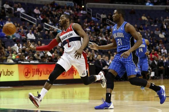 Feb 25, 2014; Washington, DC, USA; Washington Wizards point guard John Wall (2) battles for the ball with Orlando Magic small forward Maurice Harkless (21) in the first quarter at Verizon Center. Mandatory Credit: Geoff Burke-USA TODAY Sports