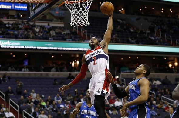 Feb 25, 2014; Washington, DC, USA; Washington Wizards point guard John Wall (2) shoots the ball in front of Orlando Magic power forward Kyle O