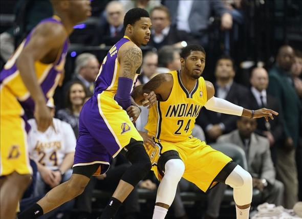 Feb 25, 2014; Indianapolis, IN, USA; Los Angeles Lakers guard Kent Bazemore (6) guards Indiana Pacers forward Paul George (24) at Bankers Life Fieldhouse. Mandatory Credit: Brian Spurlock-USA TODAY Sports