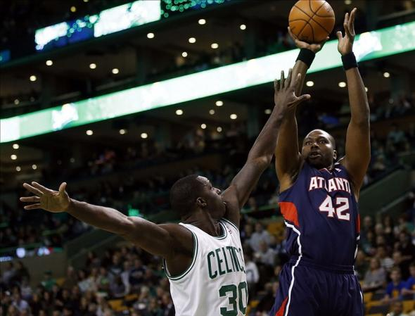 Feb 26, 2014; Boston, MA, USA; Atlanta Hawks power forward Elton Brand (42) shoots against Boston Celtics power forward Brandon Bass (30) in the first quarter at TD Garden. Mandatory Credit: David Butler II-USA TODAY Sports