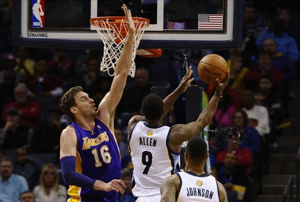 Feb 26, 2014; Memphis, TN, USA; Memphis Grizzlies shooting guard Tony Allen (9) lays the ball up against Los Angeles Lakers center Pau Gasol (16) during the game at FedExForum. Memphis Grizzlies beat Los Angeles Lakers 108 - 103. Mandatory Credit: Justin Ford-USA TODAY Sports