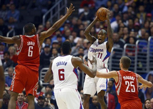Feb 26, 2014; Los Angeles, CA, USA; Los Angeles Clippers guard Jamal Crawford (11) passes against the Houston Rockets during the first quarter at Staples Center. Mandatory Credit: Kelvin Kuo-USA TODAY Sports