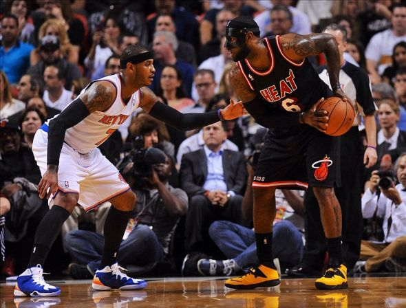 Feb 27, 2014; Miami, FL, USA; Miami Heat small forward LeBron James (6) is pressured by New York Knicks small forward Carmelo Anthony (7) during the first half at American Airlines Arena. Mandatory Credit: Steve Mitchell-USA TODAY Sports