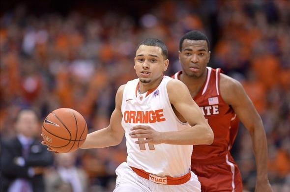 Feb 15, 2014; Syracuse, NY, USA; Syracuse Orange guard Tyler Ennis (11) on a break away basket during the second half of a game against the North Carolina State Wolfpack at the Carrier Dome. Syracuse won the game 56-55. Mandatory Credit: Mark Konezny-USA TODAY Sports