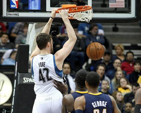Feb 19, 2014; Minneapolis, MN, USA; Minnesota Timberwolves forward Kevin Love (42) dunks during the second quarter against the Indiana Pacers at Target Center. Mandatory Credit: Brace Hemmelgarn-USA TODAY Sports