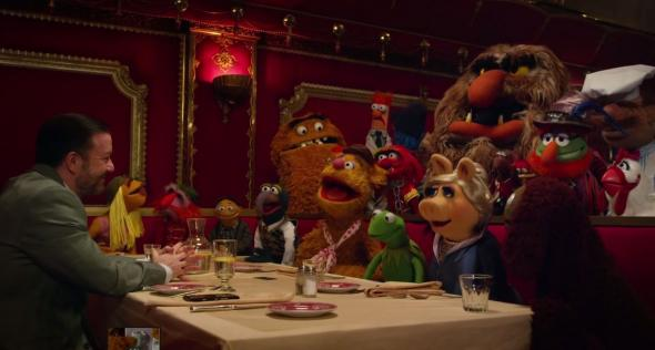 "Ricky Gervais along with the Muppets in the preview for the film ""Muppets Most Wanted."" Photo Credit: Walt Disney Studios"