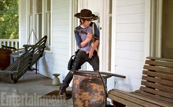 "Chandler Riggs as Carl Grimes in Season 4 of ""The Walking Dead."" Photo Credit: AMC via Entertainment Weekly"