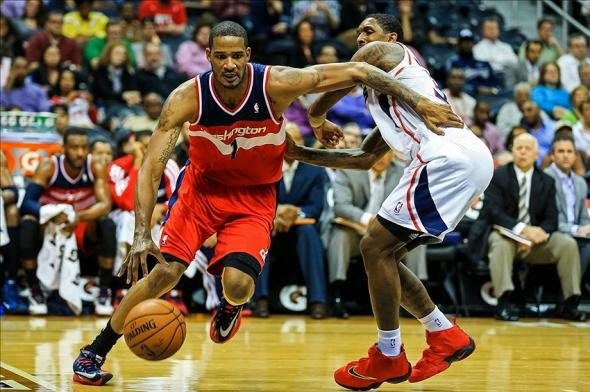 Feb 19, 2014; Atlanta, GA, USA; Washington Wizards small forward Trevor Ariza (1) drives past Atlanta Hawks shooting guard Louis Williams (3) along the baseline in the first quarter at Philips Arena. Mandatory Credit: Daniel Shirey-USA TODAY Sports