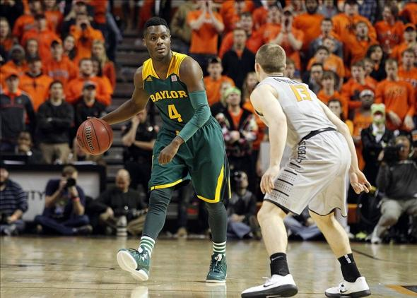Feb 1, 2014; Stillwater, OK, USA; Baylor Bears guard Gary Franklin (4) dribbles up court against Oklahoma State Cowboys guard Phil Forte, III (13) in the first half at Gallagher-Iba Arena. Mandatory Credit: Tim Heitman-USA TODAY Sports