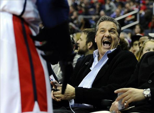 Feb 9, 2014; Washington, DC, USA; Kentucky Wildcats head coach John Calipari shares a laugh with the Washington Wizard mascot during the second half of the game against the Sacramento Kings at Verizon Center. The Wizards defeated the Kings 93 - 84. Mandatory Credit: Brad Mills-USA TODAY Sports