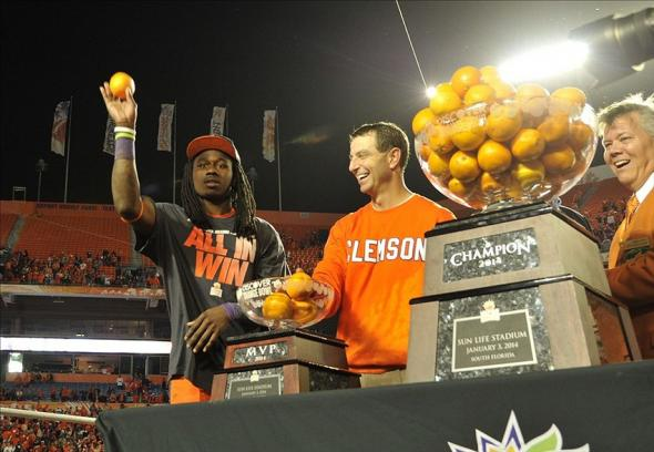 Jan 3, 2014; Miami Gardens, FL, USA; Clemson Tigers wide receiver Sammy Watkins (2) and head coach Dabo Swinney toss oranges to the crowd following the 2014 Orange Bowl at Sun Life Stadium. Clemson defeated Ohio State 40-35. Mandatory Credit: Brad Barr-USA TODAY Sports