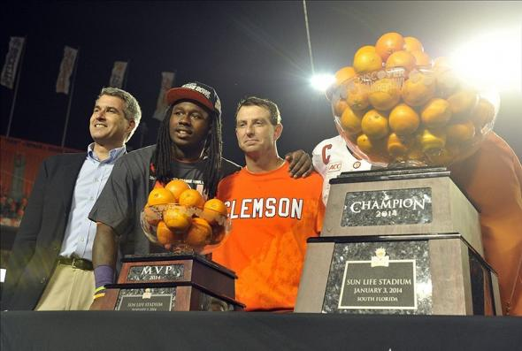 Jan 3, 2014; Miami Gardens, FL, USA; Clemson Tigers wide receiver Sammy Watkins (2) and head coach Dabo Swinney smile for the crowd following the 2014 Orange Bowl at Sun Life Stadium. Clemson defeated Ohio State 40-35. Mandatory Credit: Brad Barr-USA TODAY Sports