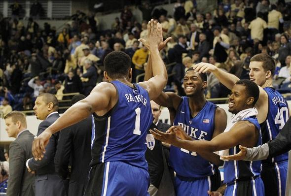Jan 27, 2014; Pittsburgh, PA, USA; Duke Blue Devils forward Jabari Parker (1) celebrates with the Duke bench as the clock winds down against the Pittsburgh Panthers during the second half at the Petersen Events Center. Duke won 80-65. Mandatory Credit: Charles LeClaire-USA TODAY Sports