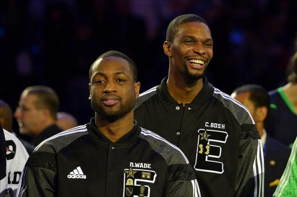 Feb 16, 2014; New Orleans, LA, USA; Eastern Conference forward Chris Bosh (1) of the Miami Heat and Eastern Conference guard Dwyane Wade (3) of the Miami Heat after the 2014 NBA All-Star Game at the Smoothie King Center. Mandatory Credit: Bob Donnan-USA TODAY Sports